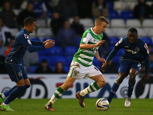 Paddy Madden of Yeovil Town takes on Glenn Belezika and Connor Brown of Oldham Athletic during the npower League One match between Oldham Athletic and Yeovil Town at Boundary Park on April 16, 2013