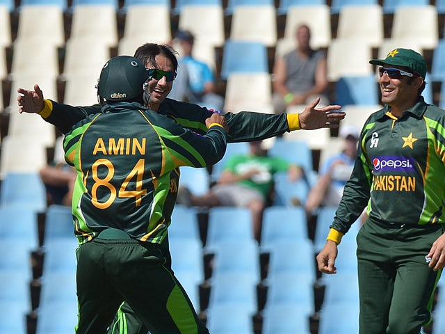 Pakistan's cricketer Saeed Ajma celebrates with team-mates after taking the wicket of South Africa's batsman Henry Davids, during the final One-Day Internationals match between South Africa and Pakistan at SuperSport in Centurion on November 30, 2013