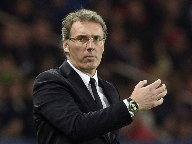 Paris Saint-Germain's coach Laurent Blanc reacts during the French L1 football match between Paris Saint-Germain (PSG) and Lyon (OL) on December 1, 2013