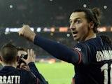 Paris Saint-Germain's Swedish forward Zlatan Ibrahimovic celebrates with teammates after scoring a goal during the French L1 football match between Paris Saint-Germain (PSG) and Lyon (OL) on December 1, 2013