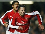 Arsenal's Dutch Striker Robin Van Persie celebrates scoring his first goal with teammate Brazilian Midfielder Denilson during their Premier League match against Chelsea at Stamford Bridge, London, on November 30, 2008