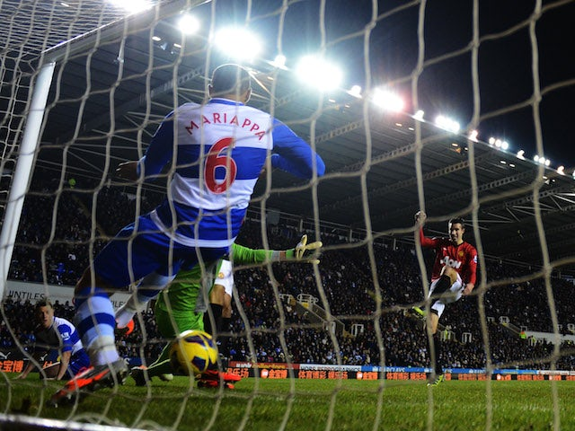 Robin van Persie of Manchester United sees his shot cross the line despite being cleared by Adrian Mariappa of Reading during the Barclays Premier League match on December 1, 2012
