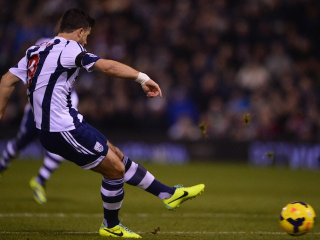 Shane Long of West Bromwich Albion scores their first goal during the Barclays Premier League match between West Bromwich Albion and Aston Villa at The Hawthorns on November 25, 2013