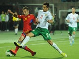 Armenia's national football team defender Levon Hayrapetyan vies with Bulgaria's national football team midfielder Simeon Slavchev during their FIFA 2014 World Cup Group B qualifying match in the Armenia's capital Yerevan, on October 11, 2013