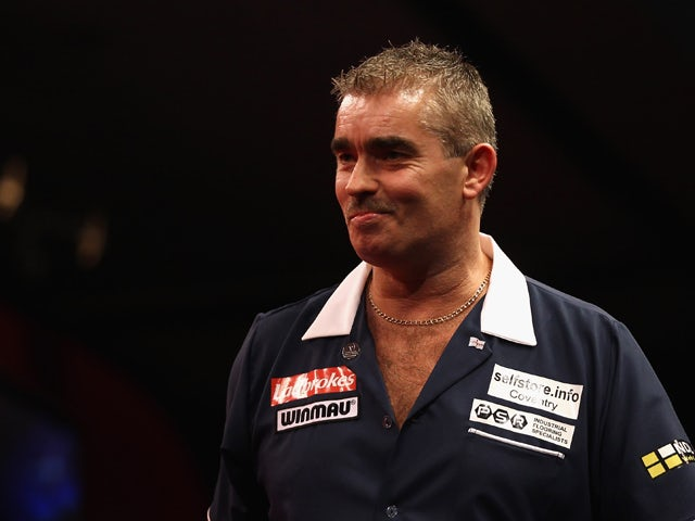 Steve Beaton of Great Britain reacts to winning his first round match against Magnus Caris of Sweden during day three of the 2012 Ladbrokes.com World Darts Championship at Alexandra Palace on December 17, 2011