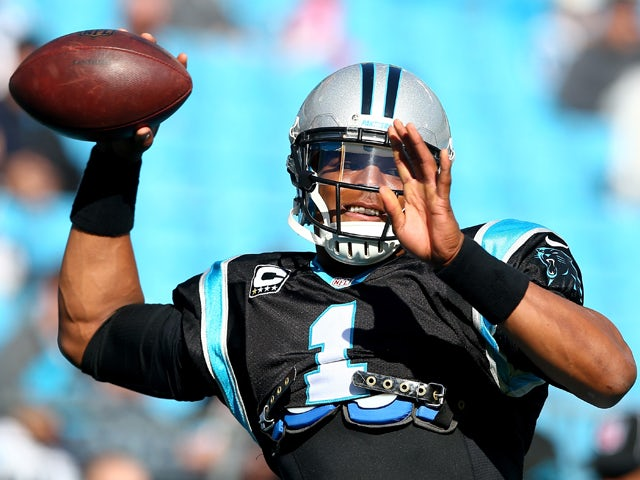 Cam Newton #1 of the Carolina Panthers warms up before their game against the Tampa Bay Buccaneers at Bank of America Stadium on December 1, 2013