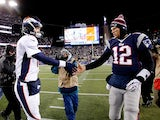 Quarterbacks Peyton Manning and Tom Brady shake hands after the New England Patriots defeated the Denver Broncos on November 24, 2013