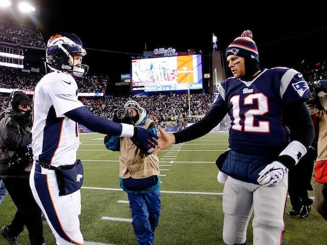 Quarterbacks Peyton Manning and Tom Brady shake hands after the New England Patriots defeated the Denver Broncos on November 24, 2013