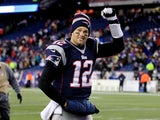 Quarterback Tom Brady of the New England Patriots walks off the field after a game at Gillette Stadium on November 24, 2013