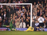 Fulham's Tomasz Radzinski celebrates after scoring his teams second goal against Arsenal during their Premier League match on November 29, 2006