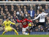 Manchester United's English striker Wayne Rooney scores a goal during the English Premier League football match between Tottenham Hotspur and Manchester United at White Hart Lane in London on December 1, 2013