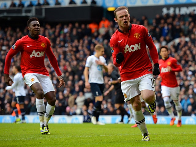 Wayne Rooney of Manchester United celebrates scoring their second goal from the penalty spot during the Barclays Premier League Match between Tottenham Hotspur and Manchester United at White Hart Lane on December 1, 2013