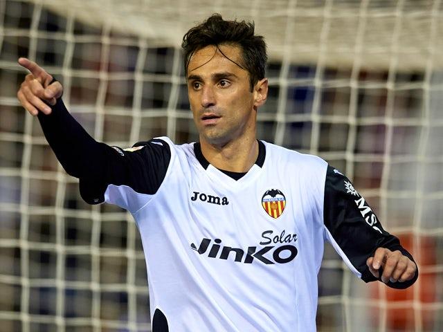 Jonas of Valencia celebrates after scoring during the La Liga match between Valencia CF and CA Osasuna at Estadio Mestalla on December 01, 2013