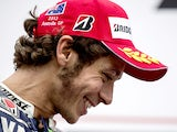Valentino Rossi of Italy and Yamaha Factory Racing celebrates third place on the podium at the end of the MotoGP race ahead of the Australian MotoGP, which is round 16 of the MotoGP World Championship at Phillip Island Grand Prix Circuit on October 20, 20