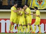 Villarreal's midfielder Bruno Soriano celebrates with his teammates after scoring during the Spanish league football match Villareal CF vs Malaga at El Madrigal stadium in Villarreal on November 29, 2013