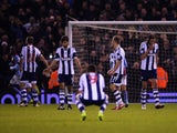 Despair for Claudio Yacob, Shane Long, James Morrison and Jonas Olsson of West Bromwich Albion as Ashley Westwood of Aston Villa scores on November 25, 2013