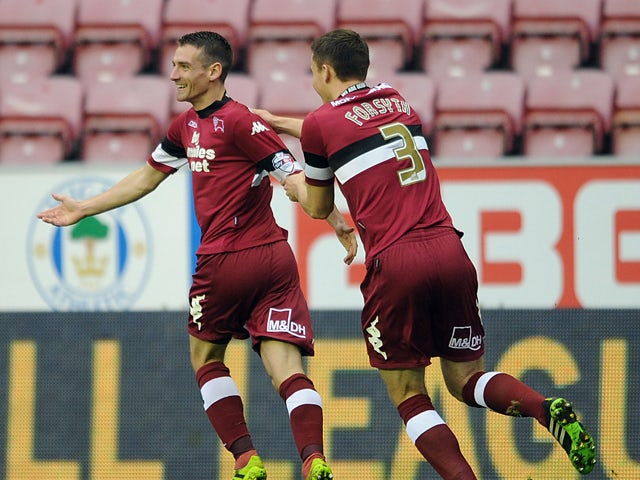 Craig Bryson of Derby County celebrates scoring the opening goal with team-mate Craig Forsyth during the Sky Bet Championship match between Wigan Athletic and Derby County at DW Stadium on December 01, 2013