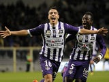 Toulouse's French forward Wissam Ben Yedder celebrates after scoring a goal during a French L1 football match between Toulouse and Sochaux on November 30, 2013