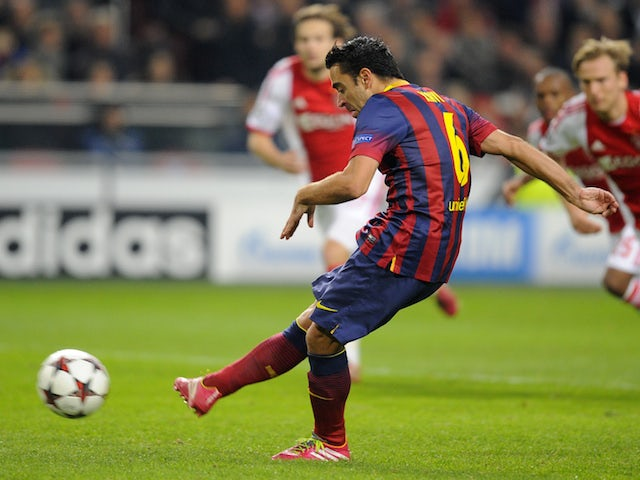 Barcelona's Spanish midfielder Xavi scores a penalty during the UEFA Champions League group H football match against Ajax on November 26, 2013