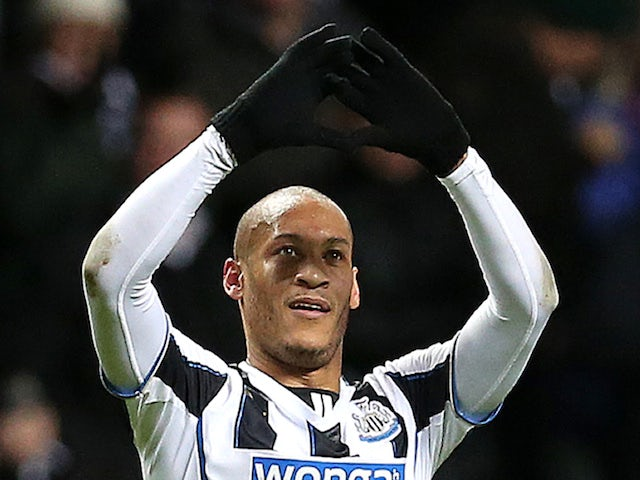 Newcastle United's French striker Yoan Gouffran celebtates scoring the opening goal during the English Premier League football match against West Bromwich Albion on November 30, 2013