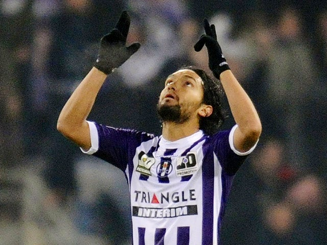 Toulouse's Abel Aguila celebrates after scoring his team's opening goal against Montpellier during their Ligue 1 match on December 8, 2013