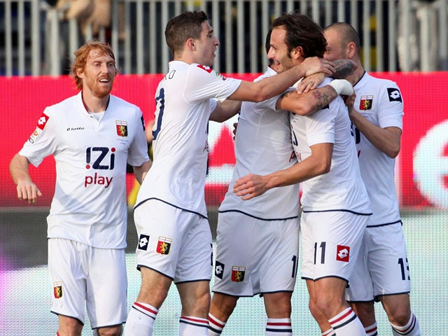 Genoa's Alberto Gilardino celebrates with teammates after scoring the opening goal against Cagliari Calcip on December 8, 2013