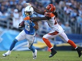 Wide receiver Keenan Allen #13 of the San Diego Chargers gets away from cornerback Adam Jones #2 of the Cincinnati Bengals at Qualcomm Stadium on December 1, 2013