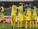 Chievo Verona's Alberto Paloschi is congratulated by teammates after scoring his team's second goal against Reggina during their Coppa Italia match on December 2, 2013