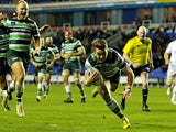 London Irish's Alex Lewington scores a try against Stade Francais Paris during their Amlin Challenge Cup match on December 8, 2013