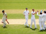Stuart Broad of England is congratulated by team mates after taking the wicket of David Warner of Australia during day one of the Second Ashes Test Match between Australia and England at Adelaide Oval on December 5, 2013