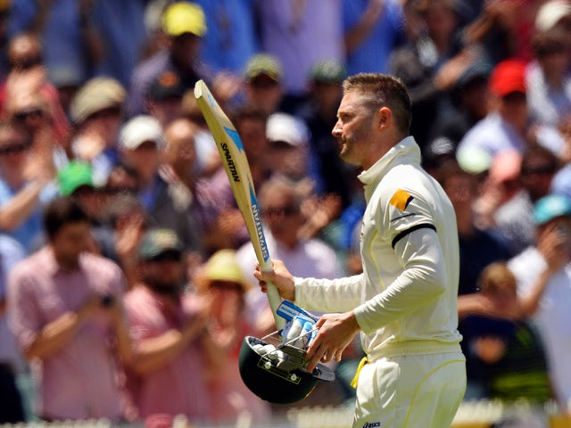 Australian captain Michael Clarke receives a standing ovation as he leaves the field following his dismissal for his 148 run innings against England during day two of the second Ashes Test cricket match in Adelaide on December 6, 2013