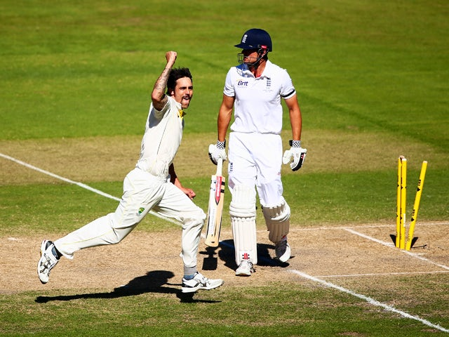 Mitchell Johnson of Australia celebrates after he took the wicket of Alastair Cook of England during day two of the Second Ashes Test Match between Australia and England at Adelaide Oval on December 6, 2013