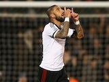 Fulham's Ashkan Dejagah celebrates after scoring the opening goal against Tottenham during their Premier League match on December 4, 2013