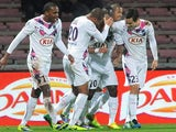 Bordeaux's players celebrate after scoring the opening goal against Guingamp during their Ligue 1 match on December 4, 2013