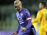 Fiorentina's Borja Valero celebrates after scoring his second goal against Hellas Verona during their Serie A match on December 2, 2013
