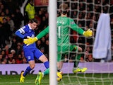 Everton's Bryan Oviedo scores the opening goal against Manchester United during their Premier League match on December 4, 2013