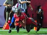 Vincent Jackson #83 of the Tampa Bay Buccaneers makes a catch for a touchdown against Nickell Robey #37 of the Buffalo Bills at Raymond James Stadium on December 8 2013