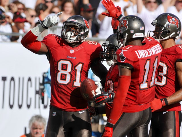 Tight end Tim Wright #81 of the Tampa Bay Buccaneers celebrates after a touchdown catch in the 2nd quarter against the Buffalo Bills December 8, 2013