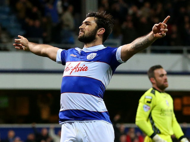 Charlie Austin of QPR scores the first goal of Bournemouth during the Sky Bet Championship match between Queens Park Rangers and Bournemouth on December 3, 2013