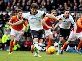 Derby's Chris Martin scores his team's opening goal via the penalty spot against Blackpool during their Championship match on December 7, 2013