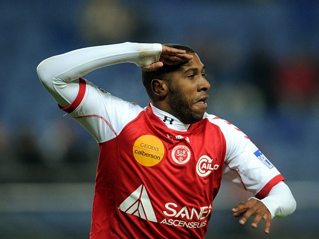 Reims' Christopher Glombard celebrates after scoring the opening goal against Sochaux during their Ligue 1 match on December 4, 2013