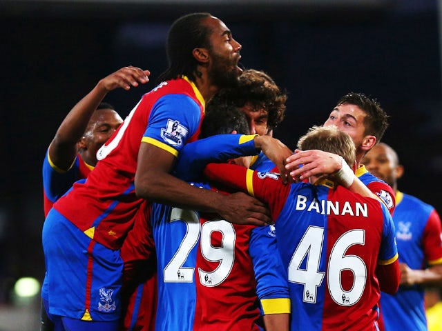 Marouane Chamakh of Crystal Palace is surrounded by team mates after scoring during the Barclays Premier League match between Crystal Palace and Cardiff City at Selhurst Park on December 07, 2013