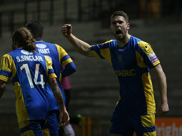 Salisbury's Dan Fithcett celebrates after scoring his team's opening goal against Port Vale during their FA Cup second round match on December 6, 2013