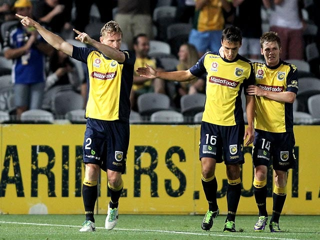 Central Coast Mariners' Daniel McBreen celebrates with teammates after scoring the opening goal against Sydney FC during their A-League match on December 7, 2013