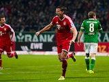 Bayern Munich's Daniel van Buyten celebrates after scoring his team's second goal against Werder Bremen during their Bundesliga match on December 7, 2013