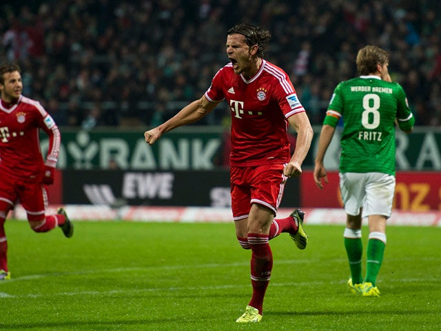 Bayern Munich's Daniel van Buyten celebrates after scoring his team's second goal against Werder Bremen during their Bundesliga match on December 7, 2013