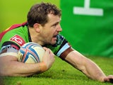 Harlequins' Danny Care scores a try against Racing Metro 92 during their Heineken Cup match on December 7, 2013