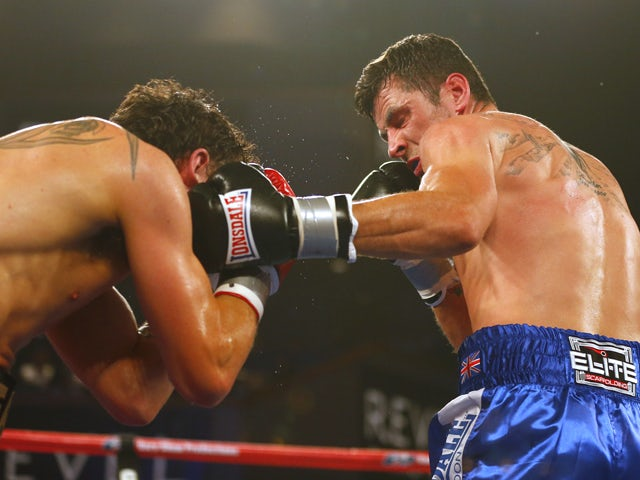 Daniel Geale, left, from Australia is hit in the face by a left punch by Darren Barker of England in the third round during their IBF Middleweight Championship fight on August 17, 2013