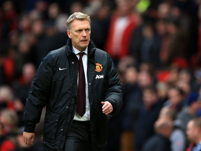 David Moyes the Manchester United manager walks off the pitch following his team's 1-0 defeat during the Barclays Premier League match between Manchester United and Newcastle United at Old Trafford on December 7, 2013