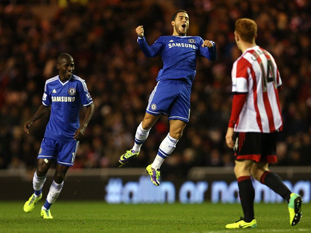 Chelsea's Eden Hazard celebrates after scoring his team's second goal against Sunderland during their Premier League match on December 4, 2013